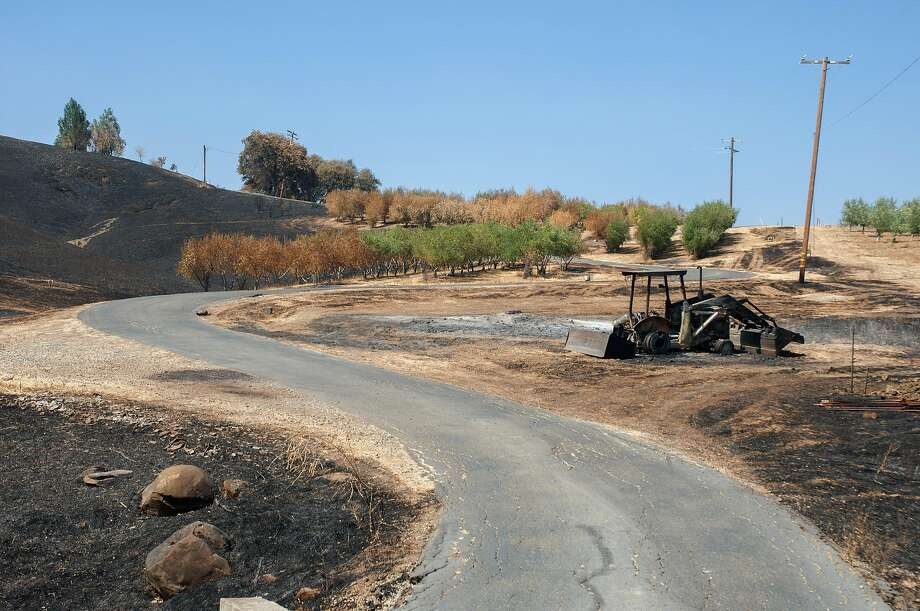 The remnants of a tractor scorched by the LNU Complex Fire sits on Kurt Balasek's property in Vacaville, Calif. on August 27, 2020. Balasek called  911 when the LNU Complex Fire approached his home on Quail Canyon Road in Vacaville, however the firefighters never came. Photo: Annika Hammerschlag / Special To The Chronicle