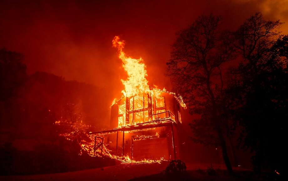 TOPSHOT - A home burns in the Spanish Flat area of Napa, California as flames rage through on August 18, 2020. - The Hennessey Fire started in the early hours of August 17 in the Napa wine region of Northern California. The fire grew to 2,700 acres in 24 hours and is 0% contained. Dozens of fires are burning out of control throughout Northern California as fire resources are spread thin. (Photo by JOSH EDELSON / AFP) (Photo by JOSH EDELSON/AFP via Getty Images) Photo: Josh Edelson / AFP Via Getty Images