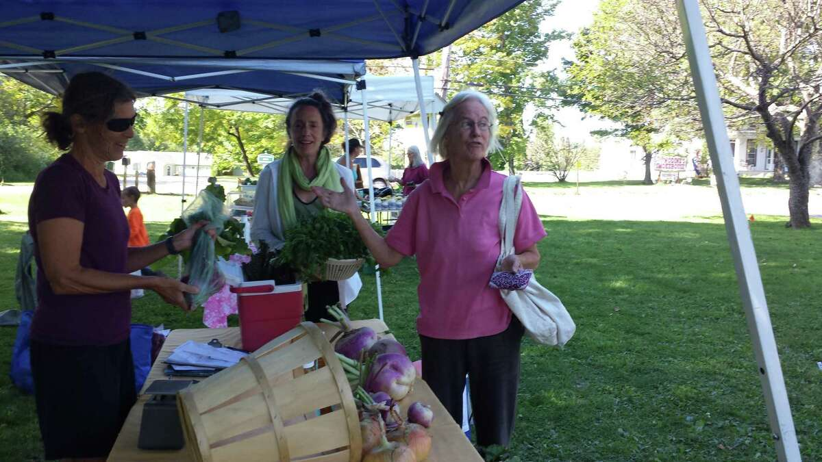 The Goshen Business Circle is promoting businesses and activities in town over the Labor Day weekend. Above, shoppers visit the farmers market.