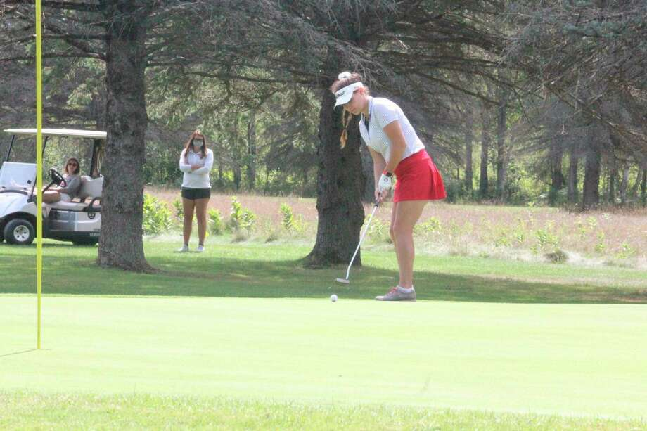 Avery Chaput, of Big Rapids, putts at The Pines Course in Canadian Lakes earlier this season. (Pioneer file photo/John Raffel)
