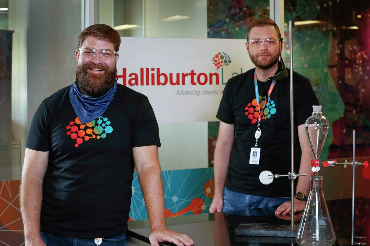 NanoTech CEO Mike Francis (l) and Halliburton Labs Executive Director Scott Gale at Halliburton's new clean energy tech lab Friday, Aug. 21, 2020, in Houston.