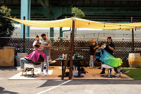 SoMa StrEat Food Park is partnering up with local barbers, turning its food truck space into part-barber shop as the city of San Francisco finally allowed outdoor haircuts to start this week.