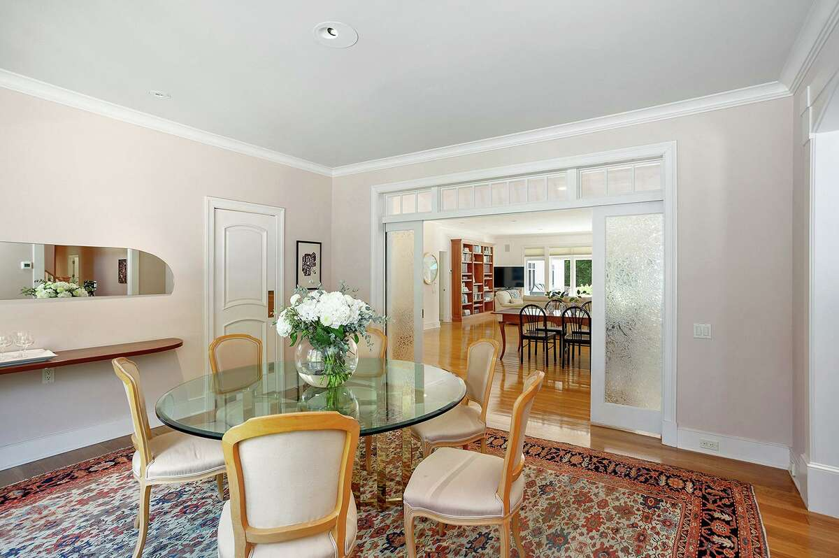 Frosted French crackle glass pocket doors separate the formal dining room from the eat-in kitchen.