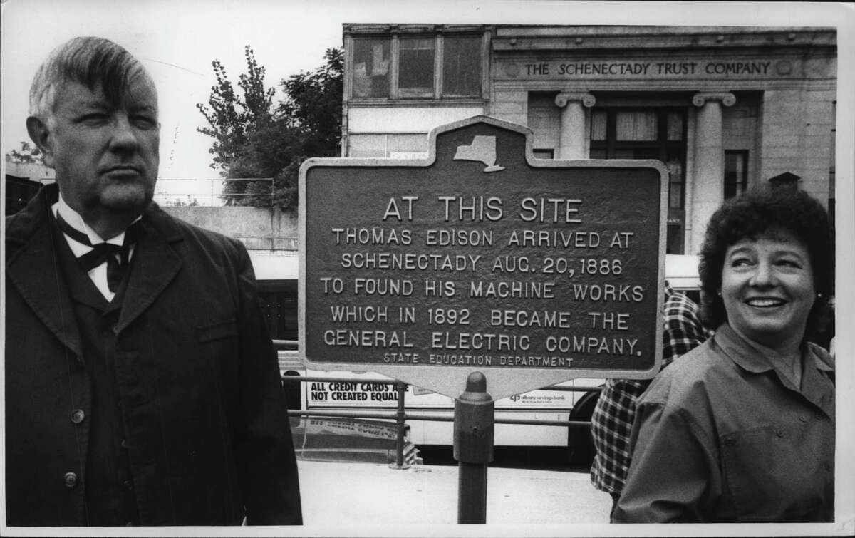 Schenectady Mayor Karen Johnson, right is all smiles as Wayne Harvey, left, former Past President of the historical society portrays Thomas Edison at the unveiling of a Thomas Edison historical plaque. They were photographed in the Amtrak parking lot on State Street. Sept. 3, 1986 (Paul D. Kniskern Sr./Times Union Archive)