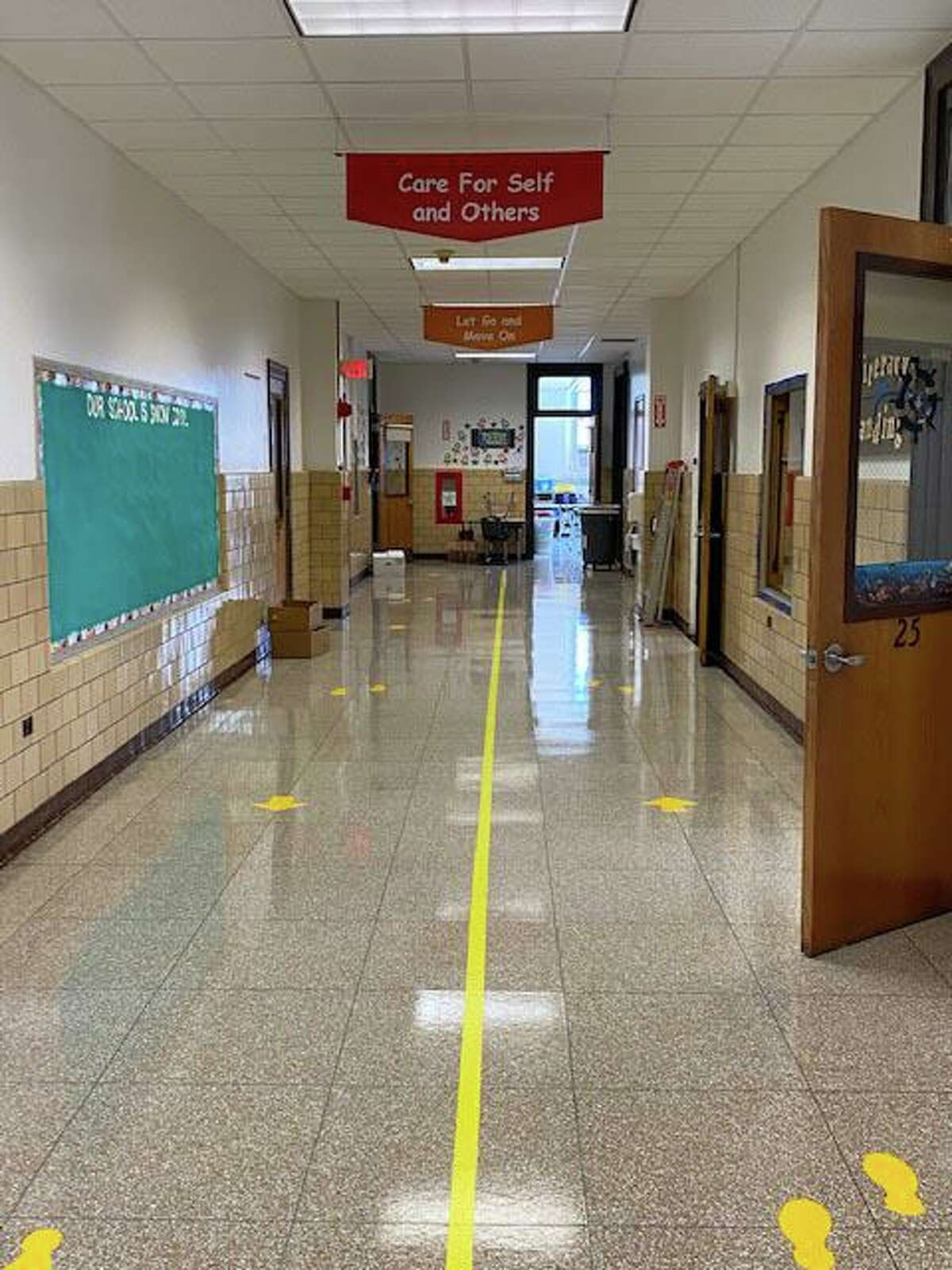 Signs and floor markings in the hallways at Old Greenwich School.
