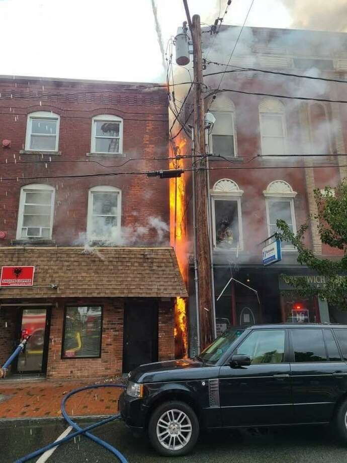 The fire Saturday involved two buildings downtown at 143 and 151-153 Main Street in Seymour. Photo: Contributed Photo / Seymour EMS