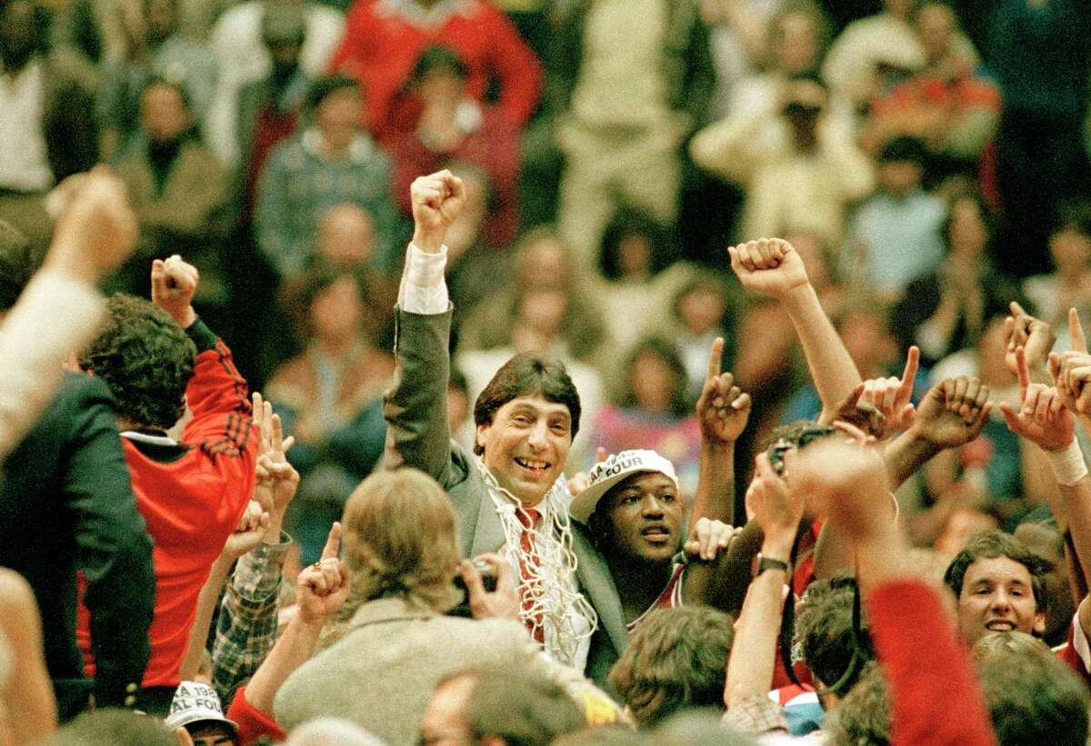 In this April 4, 1983 file photo, North Carolina State coach Jim Valvano, center with fist raised, celebrates after his basketball team defeated Houston to win the NCAA championship in Albuquerque, N.M. Valvano co-founded the V Foundation for Cancer Research shortly before his death from cancer, at age 47, in 1993.