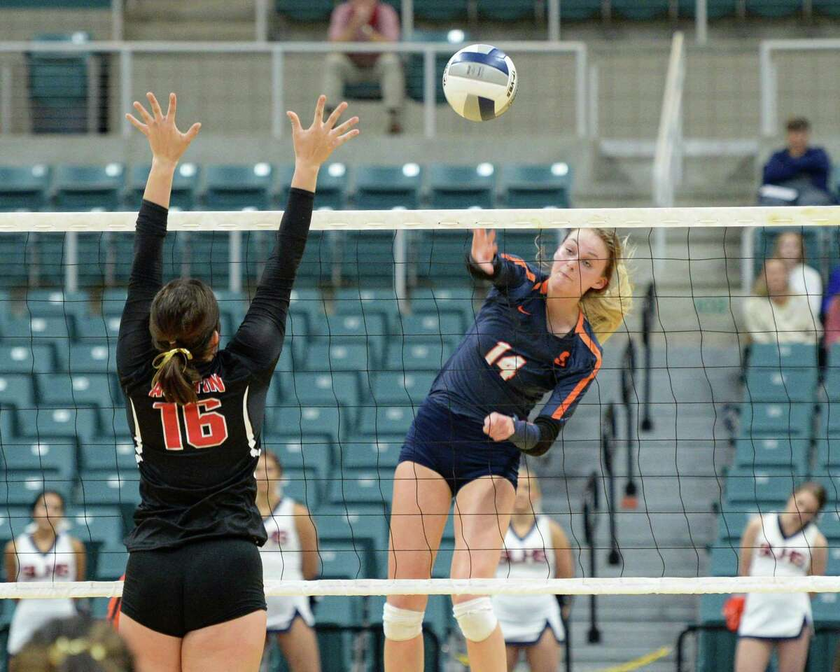 Ally Batenhorst (14) of Seven Lakes hits a shot as Rachel Pringle (16) of Austin defends during the second set of a Class 6A Region III bi-district volleyball playoff match between the Seven Lakes Spartans and the Ft. Bend Austin Bulldogs last fall at the Leonard Merrell Center in Katy.