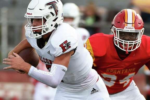Huffman quarterback Stafford quarterback Luke Thomas, left, scrambles from Stafford defensive end Quardale Patt during the first half of a high school football game, Saturday, Aug. 29, 2020, in Stafford, TX.