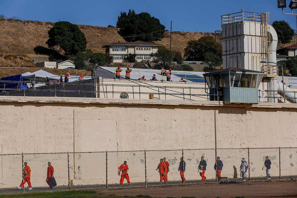 Construction workers watch the prisoners at San Quentin State Prison on Friday, Nov. 22, 2019, in San Quentin, Calif. The prison's 1,000