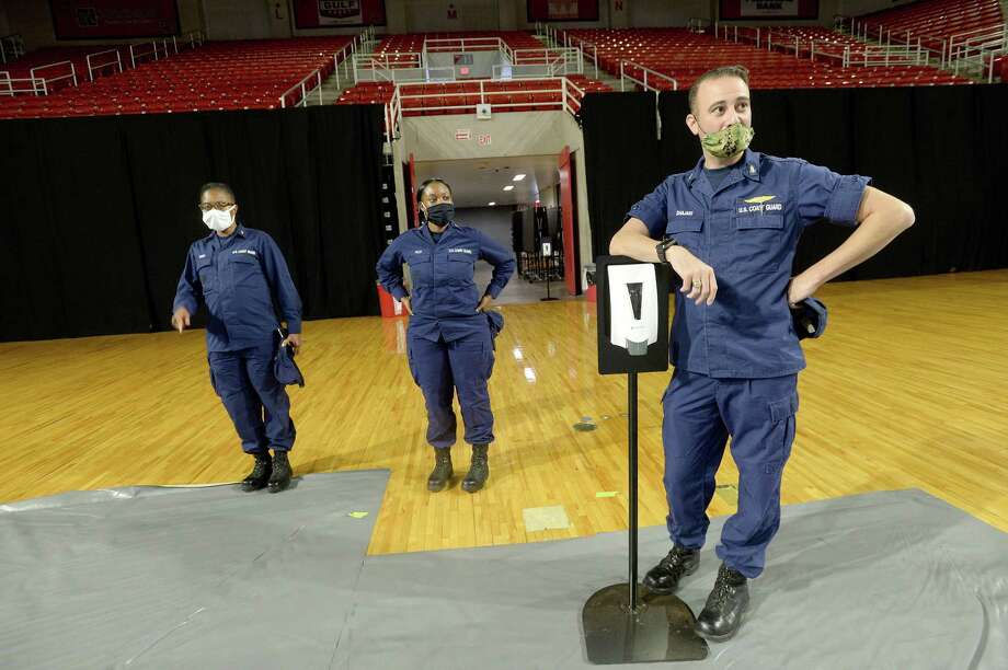 Brian Shajari talks with Ensign Samaiyah Pilot (center) and Chaplain Trina Price as he gives them a tour of the facilities at Lamar University's Montagne Center, where members of the U.S. Coast Guard are staging as they help assess damage and address storm-related issues throughout the area in the wake of Hurricane Laura. Photo taken Tuesday, September 1, 2020 Kim Brent/The Enterprise Photo: Kim Brent / The Enterprise / BEN