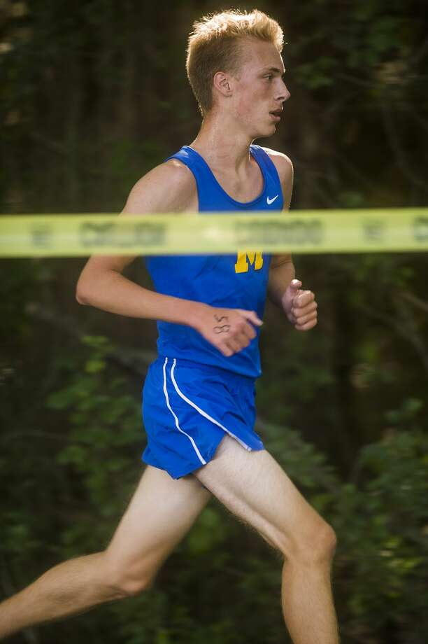 Midland's Matt Crowley competes in a cross country meet against runners from Dow, Meridian and Bullock Creek Wednesday, Sept. 2, 2020 at Stratford Woods Park in Midland. (Katy Kildee/kkildee@mdn.net) Photo: (Katy Kildee/kkildee@mdn.net)