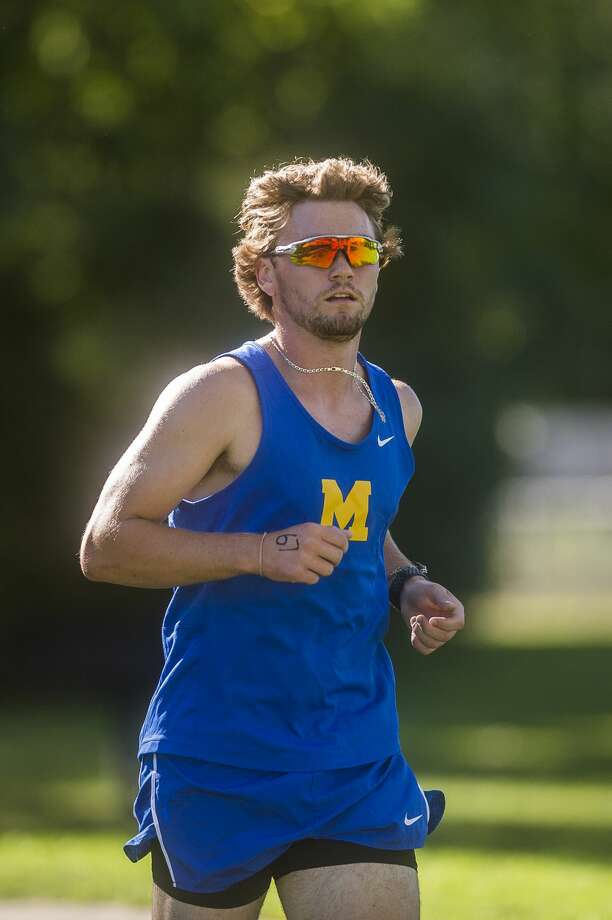 Midland's Al Money competes in a cross country meet against runners from Dow, Meridian and Bullock Creek Wednesday, Sept. 2, 2020 at Stratford Woods Park in Midland. (Katy Kildee/kkildee@mdn.net) Photo: (Katy Kildee/kkildee@mdn.net)