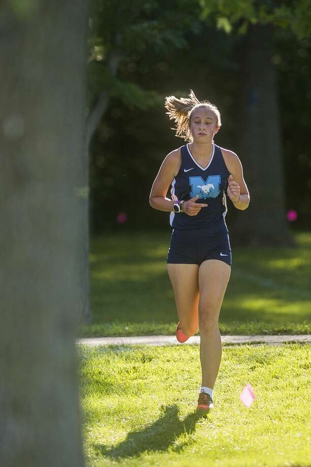 Meridian's Lauren Brawt competes in a cross country meet against runners from Midland, Dow and Bullock Creek Wednesday, Sept. 2, 2020 at Stratford Woods Park in Midland. (Katy Kildee/kkildee@mdn.net) Photo: (Katy Kildee/kkildee@mdn.net)