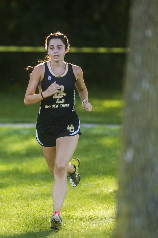 Bullock Creek's Rita Gorsuch competes in a cross country meet against runners from Dow, Meridian and Midland Wednesday, Sept. 2, 2020 at Stratford Woods Park in Midland. (Katy Kildee/kkildee@mdn.net) Photo: (Katy Kildee/kkildee@mdn.net)