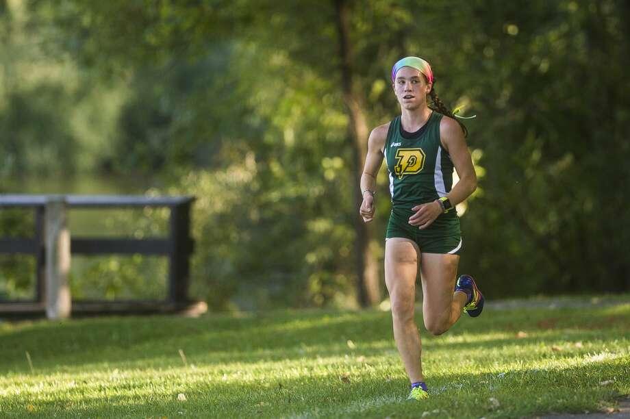Dow's Katie Watkins competes in a cross country meet against runners from Midland, Meridian and Bullock Creek Wednesday, Sept. 2, 2020 at Stratford Woods Park in Midland. (Katy Kildee/kkildee@mdn.net) Photo: (Katy Kildee/kkildee@mdn.net)