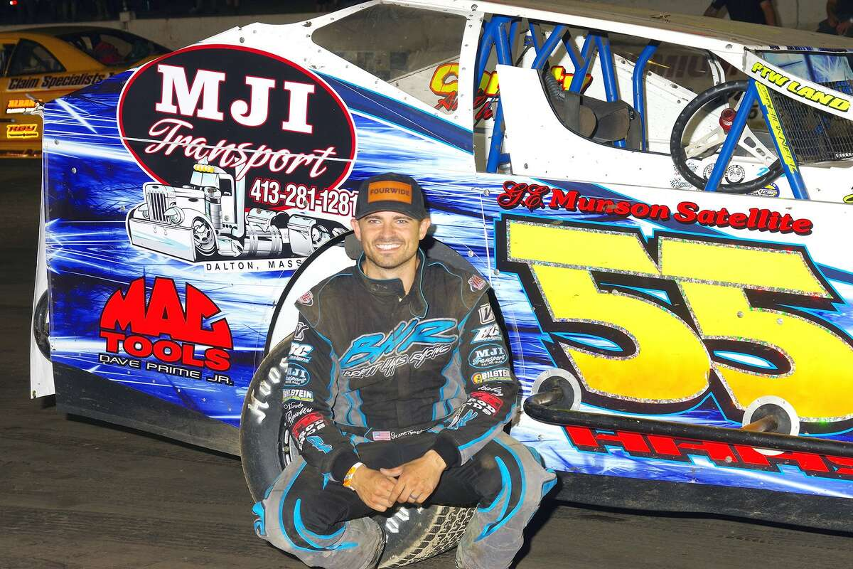 Brett Haas poses with his racecar. (Courtesy of Mark Brown Photography)