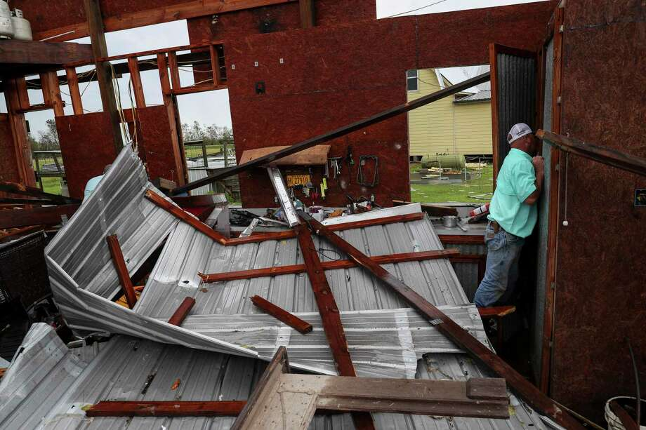 Nicholas Leonards looks for roofing nails to repair his own roof in his brother-in-law's destroyed shop Friday, Aug. 28, 2020, in Holmwood. Photo: Jon Shapley, Houston Chronicle / Staff Photographer / © 2020 Houston Chronicle