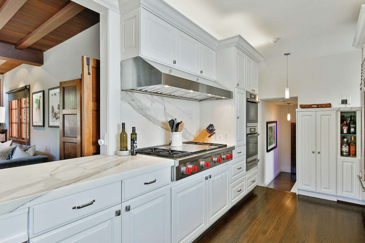 The kitchen is modern and open, with plenty of storage.