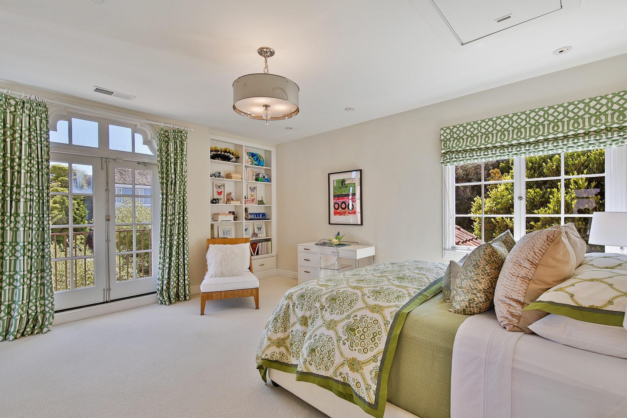 The bedrooms overlook the oversized, lush property as well as the sea beyond.