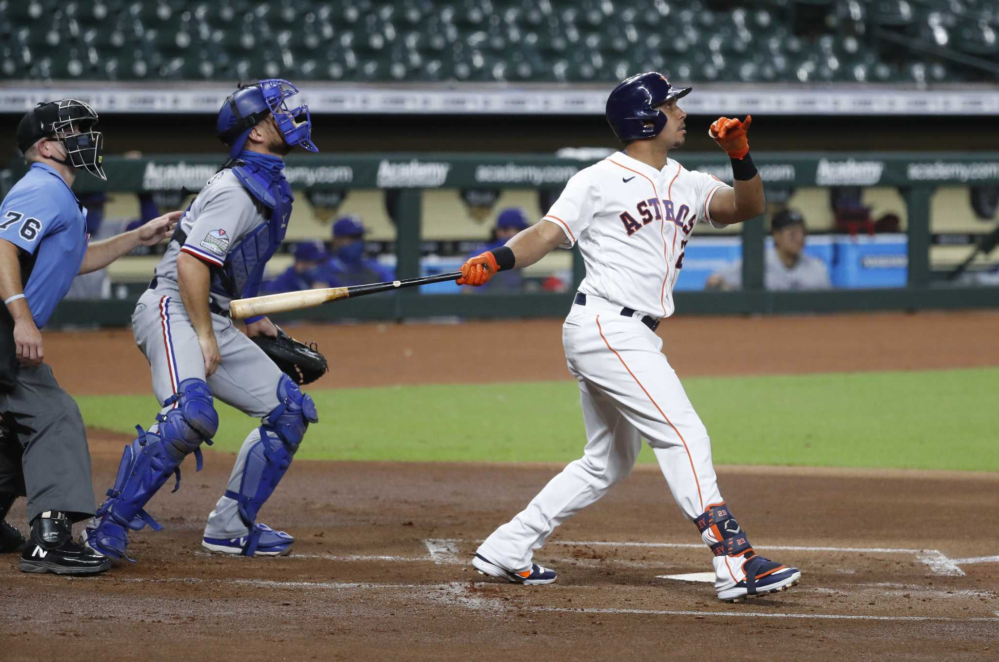 Michael Brantley homers early, Astros hold on for win over Texas