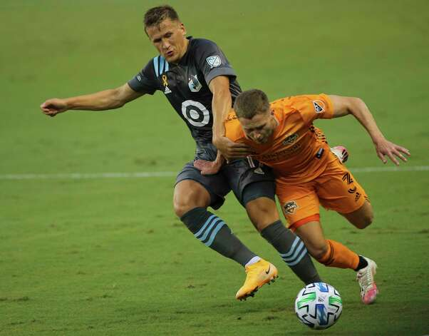 Minnesota United midfielder Robin Lod (17) tries to stop Houston Dynamo defender Adam Lundqvist (3)  during the first half of a MLS match Wednesday, Sept. 2, 2020, at BBVA Stadium in Houston. Photo: Yi-Chin Lee, Staff Photographer / © 2020 Houston Chronicle