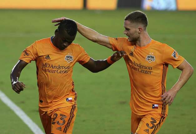 Houston Dynamo defender Adam Lundqvist (3) congrats forward Darwin Quintero (23) with his goal at the 28th minutes of a MLS match against the Minnesota United Wednesday, Sept. 2, 2020, at BBVA Stadium in Houston. Photo: Yi-Chin Lee, Staff Photographer / © 2020 Houston Chronicle
