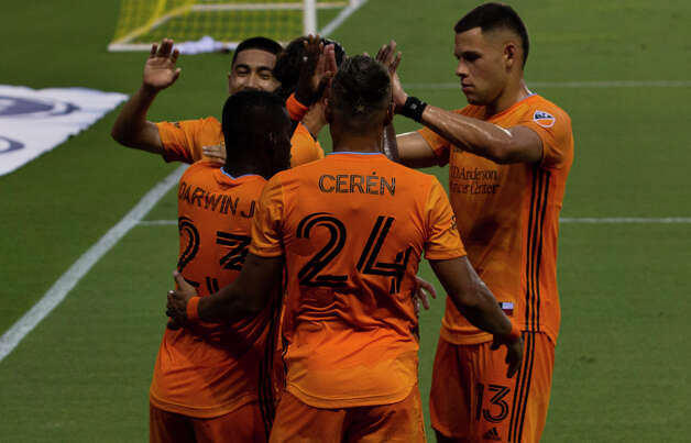 Houston Dynamo players celebrating forward Darwin Quintero (23) scoring a goal at the 28th minutes of a MLS match against the Minnesota United Wednesday, Sept. 2, 2020, at BBVA Stadium in Houston. Photo: Yi-Chin Lee, Staff Photographer / © 2020 Houston Chronicle