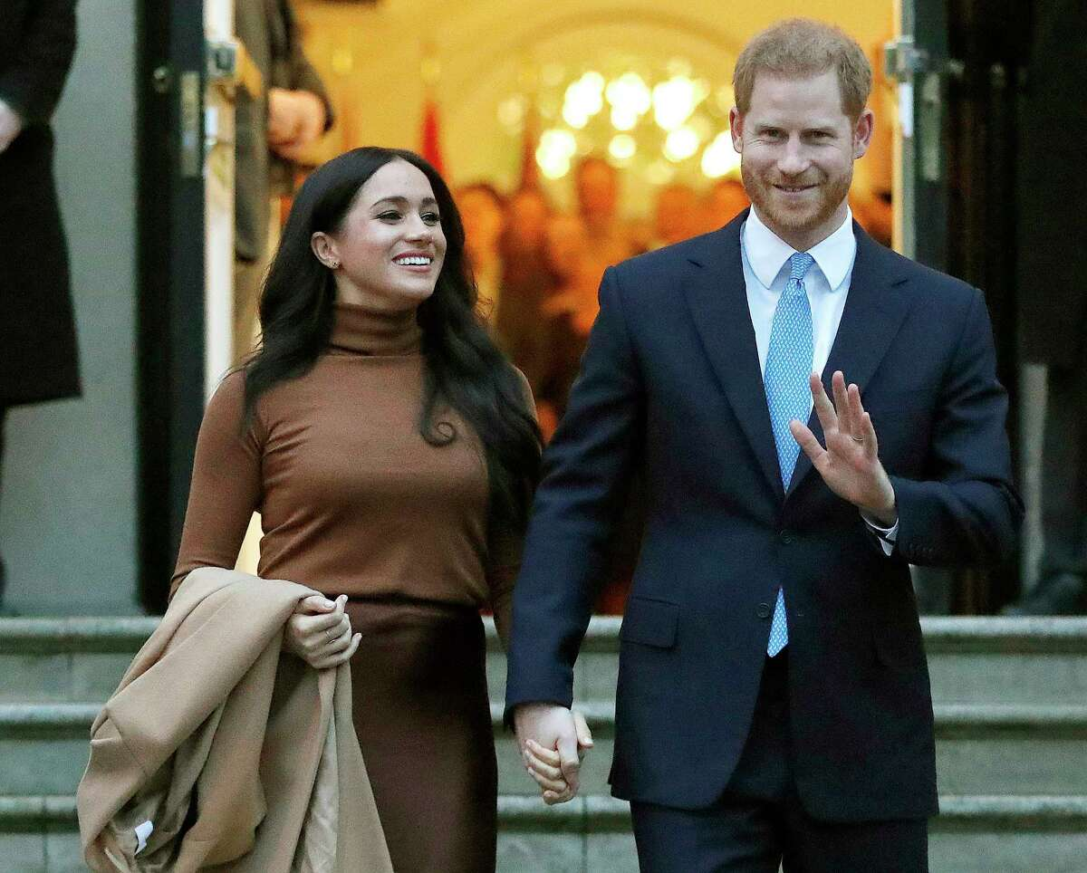 FILE - In this Jan. 7, 2020, file photo, Britain's Prince Harry and Meghan, Duchess of Sussex leave Canada House in London. Six months after detangling their work lives from the British royal family, the couple have signed a multiyear deal with Netflix. According to a statement Wednesday, they plan to produce nature series, documentaries and childrena€™s programming through a new production company. The two recently relocated to Santa Barbara, California, with baby Archie. (AP Photo/Frank Augstein, File)