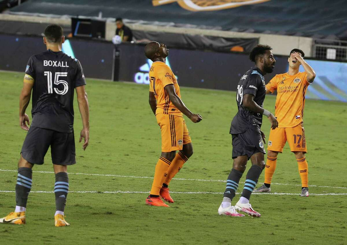 Houston Dynamo players react to not scoring a goal against the Minnesota United during the second half of a MLS match Wednesday, Sept. 2, 2020, at BBVA Stadium in Houston. The Houston Dynamo defeated the Minnesota United 3-0.