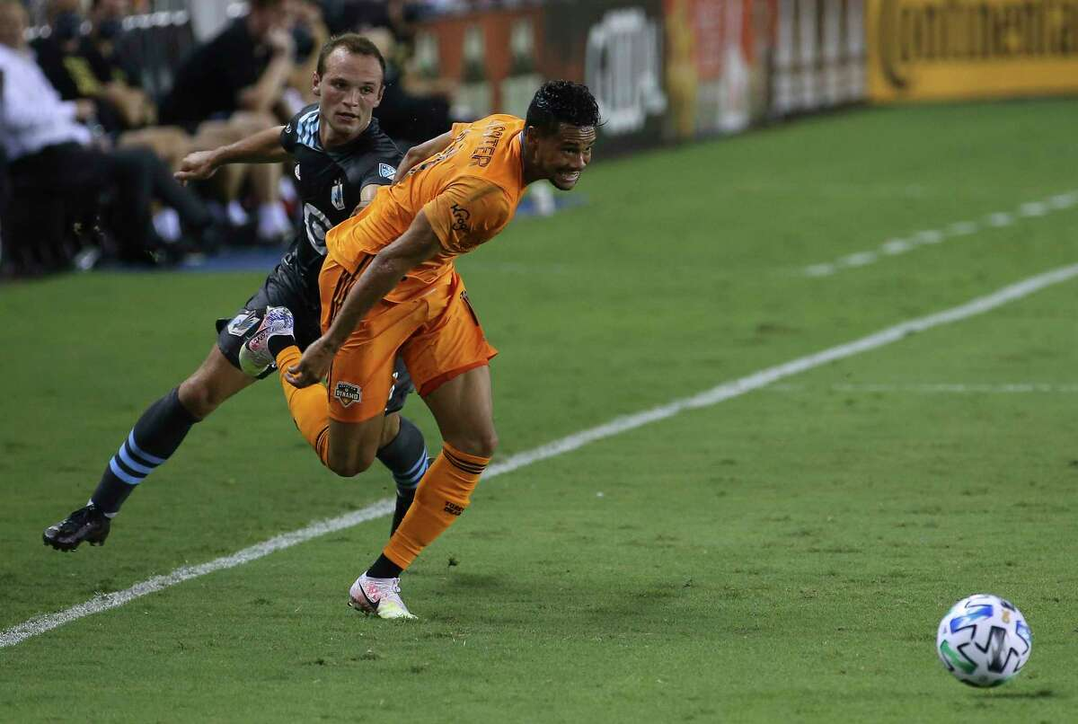 Minnesota United defender Chase Gasper (77) tries to stop Houston Dynamo forward Ariel Lassiter (11) getting control of the ball during the second half of a MLS match Wednesday, Sept. 2, 2020, at BBVA Stadium in Houston. The Houston Dynamo defeated the Minnesota United 3-0.