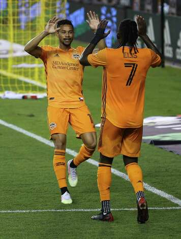 Houston Dynamo forward Ariel Lassiter (11) celebrates his  goal with Alberth Elis (7), who assisted the goal, during the second half of a MLS match against the Minnesota United Wednesday, Sept. 2, 2020, at BBVA Stadium in Houston. The Houston Dynamo defeated the Minnesota United 3-0. Photo: Yi-Chin Lee, Staff Photographer / © 2020 Houston Chronicle