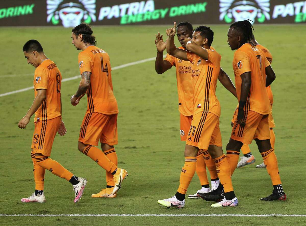 Houston Dynamo forward Ariel Lassiter (11) celebrates his goal during the second half of a MLS match against the Minnesota United Wednesday, Sept. 2, 2020, at BBVA Stadium in Houston. The Houston Dynamo defeated the Minnesota United 3-0.