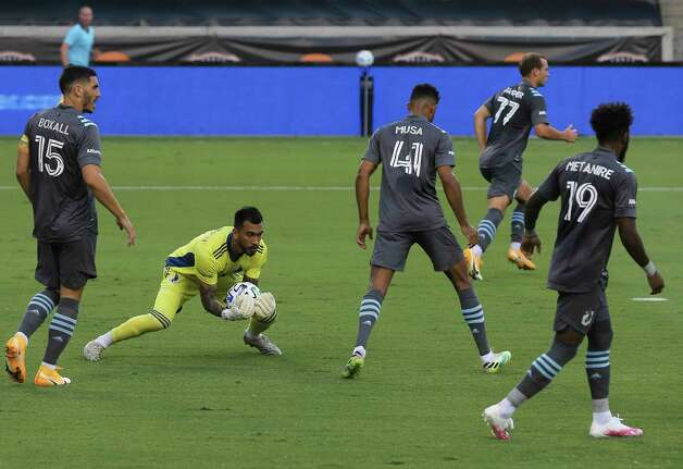 Minnesota United goalkeeper Greg Ranjitsingh (18) catches the ball during the first half of a MLS match against the Houston Dynamo Wednesday, Sept. 2, 2020, at BBVA Stadium in Houston. Photo: Yi-Chin Lee, Staff Photographer / © 2020 Houston Chronicle