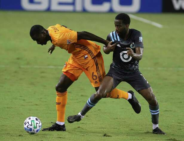 Houston Dynamo midfielder Wilfried Zahibo (6) battles with Minnesota United midfielder Kevin Molino (7) for control of the ball during the second half of a MLS match Wednesday, Sept. 2, 2020, at BBVA Stadium in Houston. The Houston Dynamo defeated the Minnesota United 3-0. Photo: Yi-Chin Lee, Staff Photographer / © 2020 Houston Chronicle