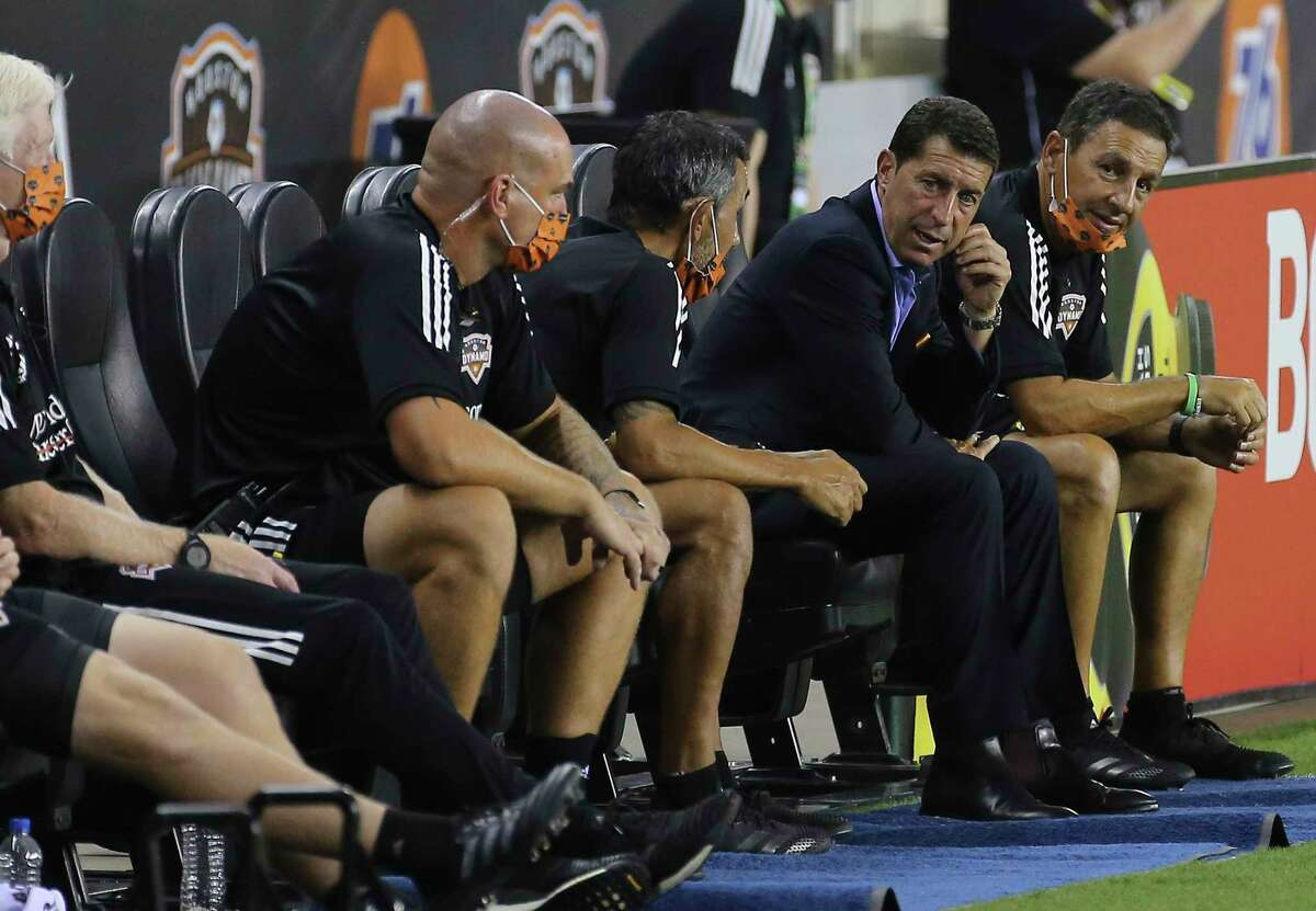 Houston Dynamo Head Coach Tab Ramos, second right, talks to his coaching staff during the second half of a MLS match against the Minnesota United Wednesday, Sept. 2, 2020, at BBVA Stadium in Houston. The Houston Dynamo defeated the Minnesota United 3-0.