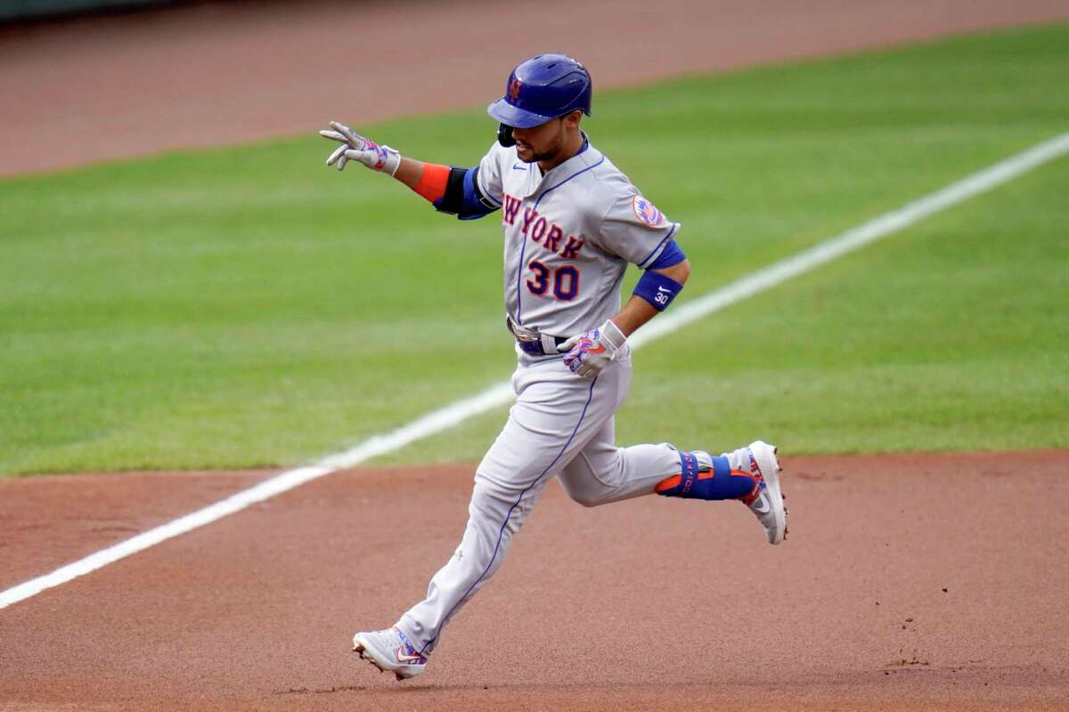 New York Mets' Michael Conforto runs the bases after hitting a two-run home run off Baltimore Orioles starting pitcher John Means during the first inning of a baseball game, Wednesday, Sept. 2, 2020, in Baltimore. Mets designated hitter J.D. Davis scored on the home run. (AP Photo/Julio Cortez)