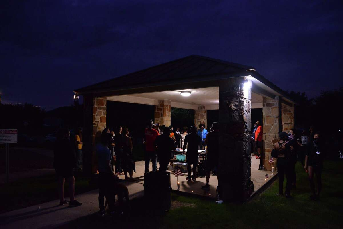 Brendan Daniels (blue shirt) speaks to supoorters of his brother during a memorial vigil Wednesday evening for Damian Daniels who was killed by Bexar County Deputies during a struggle over a handgun last week.