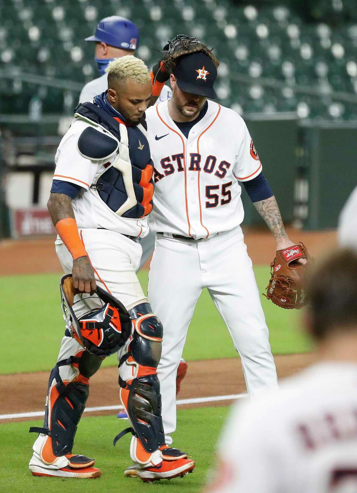 Houston Astros catcher Martin Maldonado (15) hugs pitcher Ryan Pressly (55) after Texas Rangers Nick Solak struck out swinging to end an MLB baseball game at Minute Maid Park, Wednesday, September 2, 2020, in Houston. Astros won 2-1 against the Texas Rangers.