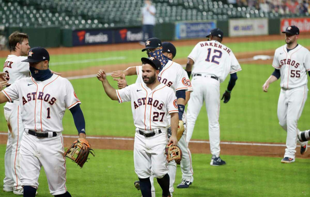 Houston Astros Jose Altuve (27) and teammates celebrate after the Astros beat the Texas Rangers 2-1 after an MLB baseball game at Minute Maid Park, Wednesday, September 2, 2020, in Houston.