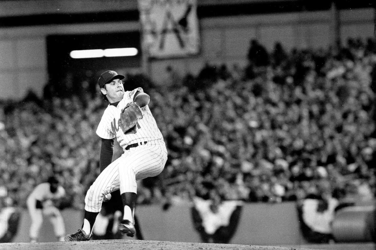 FILE - In this Oct. 16, 1973, file photo, New York Mets pitcher Tom Seaver winds up during first inning of Game 3 of the World Series against the Oakland Athletics at Shea Stadium in New York. Seaver, the galvanizing leader of the Miracle Mets 1969 championship team and a pitcher who personified the rise of expansion teams during an era of radical change for baseball, has died. He was 75. The Hall of Fame said Wednesday night, Sept. 2, 2020, that Seaver died Aug. 31 from complications of Lewy body dementia and COVID-19. (AP Photo, File)