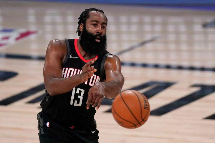 Houston Rockets' James Harden (13) makes a pass during the second half of an NBA first-round playoff basketball game against the Oklahoma City Thunder in Lake Buena Vista, Fla., Wednesday, Sept. 2, 2020. (AP Photo/Mark J. Terrill)