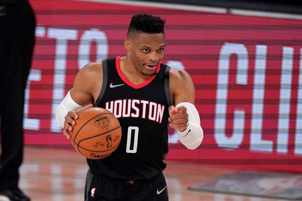Houston Rockets' Russell Westbrook (0) gestures to teammates during the second half of an NBA first-round playoff basketball game against the Oklahoma City Thunder in Lake Buena Vista, Fla., Wednesday, Sept. 2, 2020. (AP Photo/Mark J. Terrill)