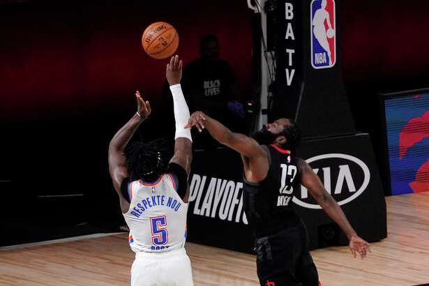 Oklahoma City Thunder's Luguentz Dort (5) has his 3-point shot attempt blocked by Houston Rockets' James Harden (13) during the second half of an NBA first-round playoff basketball game in Lake Buena Vista, Fla., Wednesday, Sept. 2, 2020. (AP Photo/Mark J. Terrill)