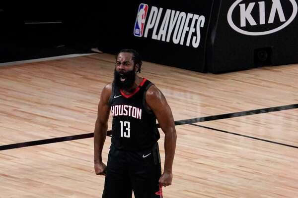 Houston Rockets' James Harden (13) celebrates after blocking a 3-point shot attempt by Oklahoma City Thunder's Luguentz Dort (5) during the second half of an NBA first-round playoff basketball game in Lake Buena Vista, Fla., Wednesday, Sept. 2, 2020. (AP Photo/Mark J. Terrill)