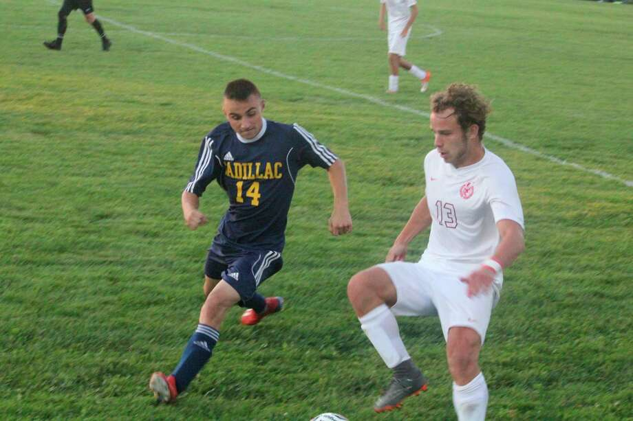 Big Rapids' Alec Bollman works at controlling the ball against Cadillac on Wednesday. (Pioneeer photo/John Raffel)