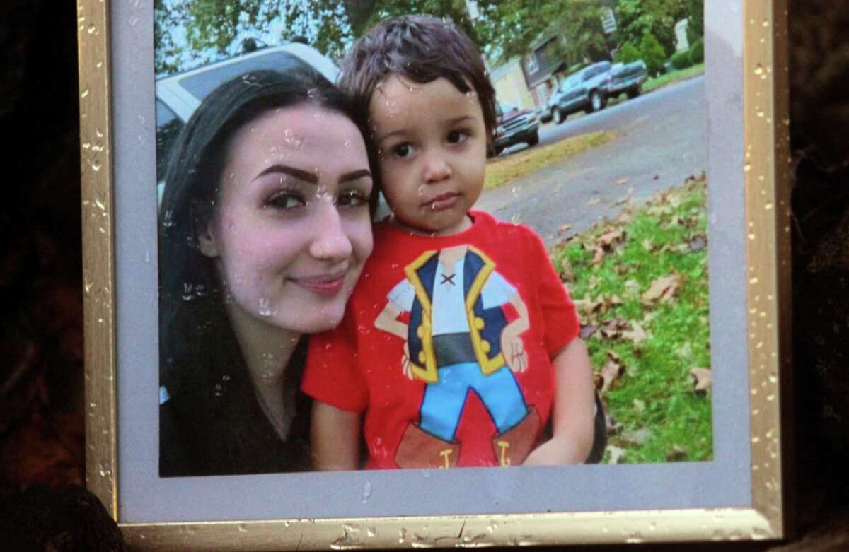 A photo of Rosalie Acquefreda, 20, and her son Eli, 3, is on display at a memorial setup near the spot where she died from a stabbing on Coe Lane in Ansonia, Conn., on Tuesday Sept. 2, 2020. Ansonia police announced that they have arrested Andre LeFrancois, 22, for the homicide of Rosalie Acquefreda.