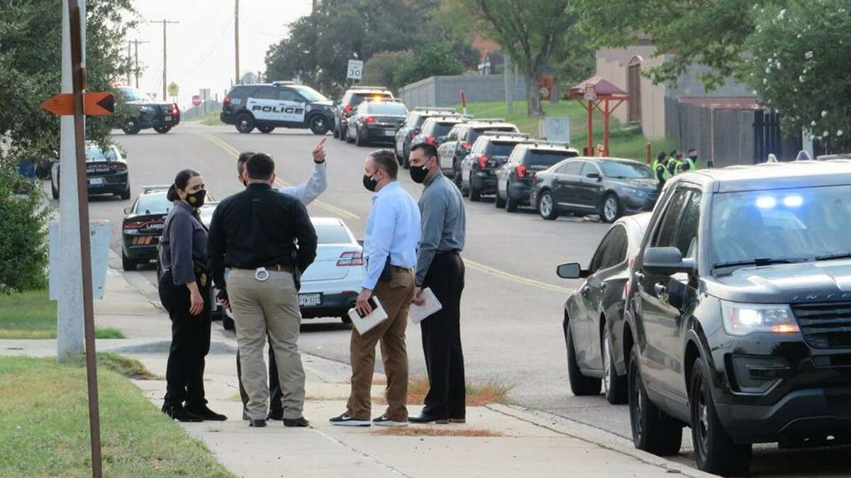 Laredo police investigators are seen in the area where a standoff was reported. Authorities said that Shiloh Drive was shutdown between Shama Circle and McPherson Road for an