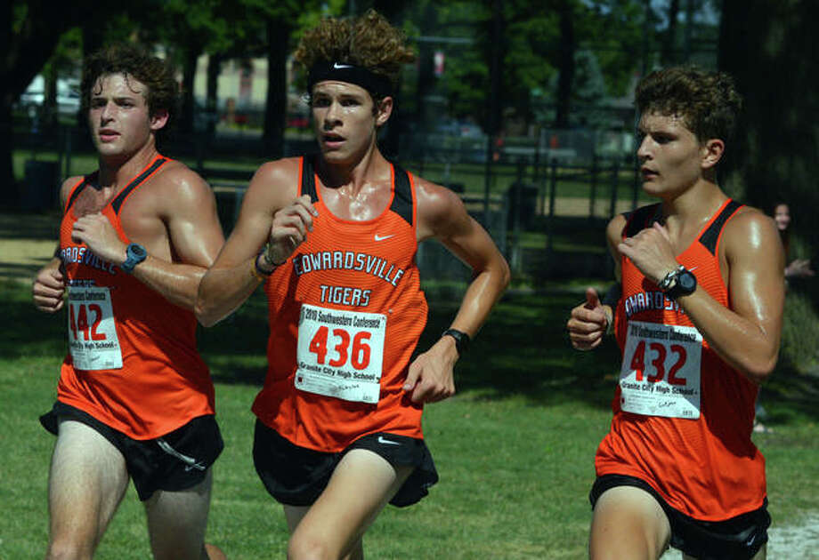 Edwardsville runners, left to right, Drew Stover, Geordan Patrylak and Ryan Luitjohan compete in a season-opening dual meet on Aug. 28 at Granite City. Photo: Scott Marion/The Intelligencer