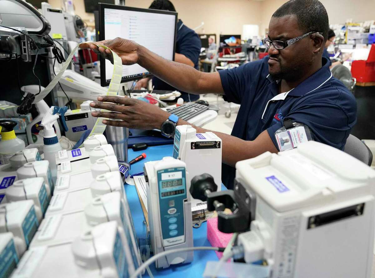 Charles Manuel, a biomedical tech, works on equipment at US Med-Equip, 7028 Gessner Rd., Tuesday, Feb. 18, 2020, in Houston. US Med-Equip is a major supplier of movable medical devices such as respirators, infusion equipment and neo-natal incubators, to hospitals and other health care facilities across the country.